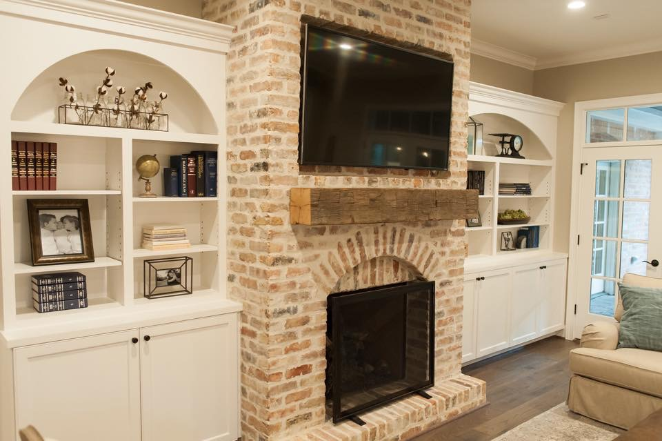 brick fireplace with tv