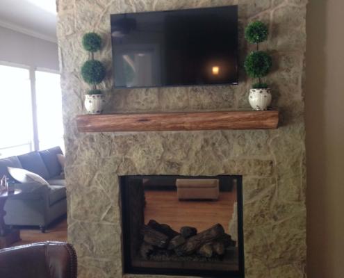 custom stone indoor fireplace