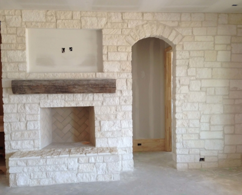 indoor decorative brick wall and fireplace